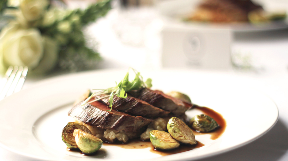 Roast fillet of beef on pushed new potatoes, sautéed brussels sprouts with red wine sauce