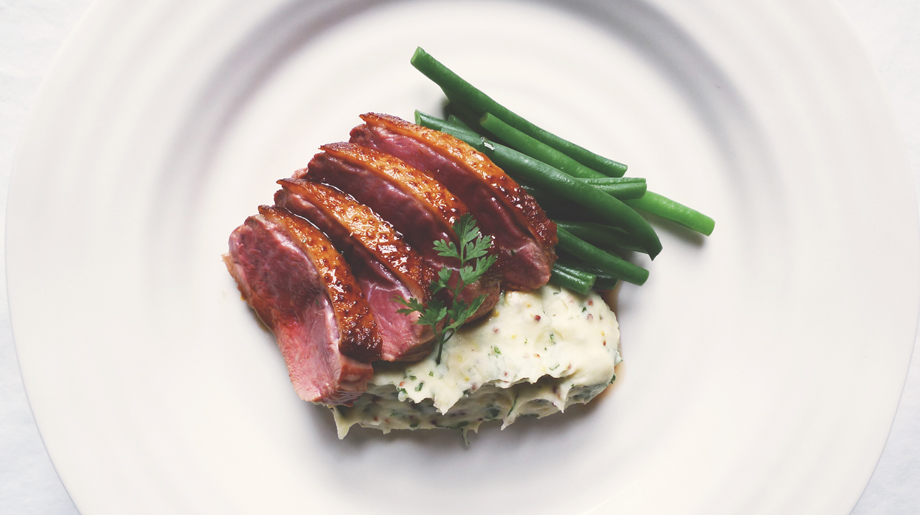 Roast duck breast with green beans and grain mustard mashed potato